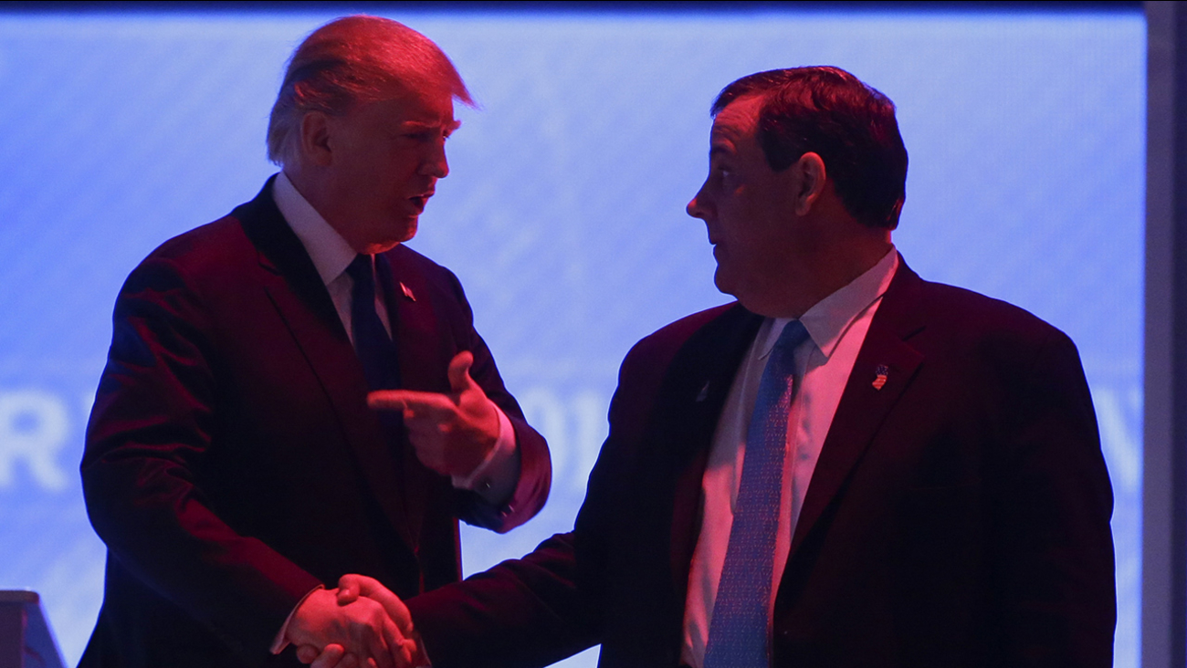 Republican presidential candidate, businessman Donald Trump, left, and former Repub. presidential candidate, New Jersey Gov. Chris Christie talk during a debate commercial break