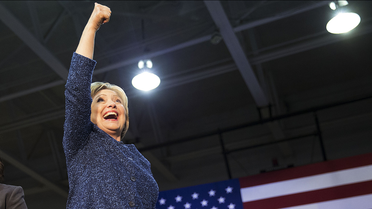 Democratic presidential candidate, Hillary Clinton gestures to the crowd as she takes the stage for a campaign event at Miles College Saturday, Feb. 27, 2016