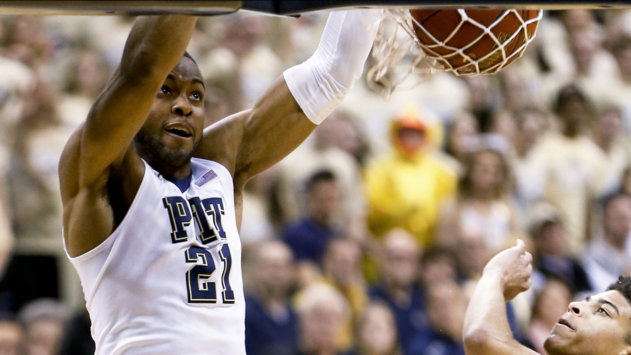 Pittsburgh's Sheldon Jeter (21) dunks past Duke's Derryck Thornton during the first half of an NCAA college basketball game, Sunday, Feb. 28, 2016, in Pittsburgh.