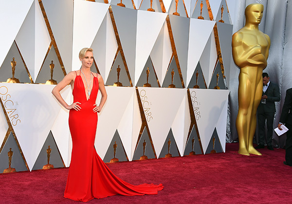 "<div class=""meta image-caption""><div class=""origin-logo origin-image ap""><span>AP</span></div><span class=""caption-text"">Charlize Theron arrives at the Oscars on Sunday, Feb. 28, 2016, at the Dolby Theatre in Los Angeles. (Jordan Strauss/Invision/AP)</span></div>"