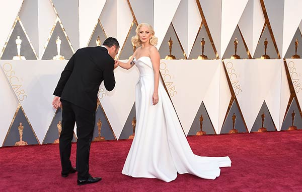 "<div class=""meta image-caption""><div class=""origin-logo origin-image ap""><span>AP</span></div><span class=""caption-text"">Lady Gaga and her fiance, actor Taylor Kinney, arrive at the Oscars on Sunday, Feb. 28, 2016, at the Dolby Theatre in Los Angeles. (Jordan Strauss/Invision/AP)</span></div>"