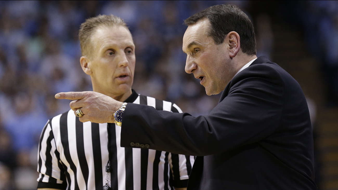 Duke head coach Mike Krzyzewski speaks with an official during the second half of an NCAA college basketball game against North Carolina in Chapel Hill, N.C.