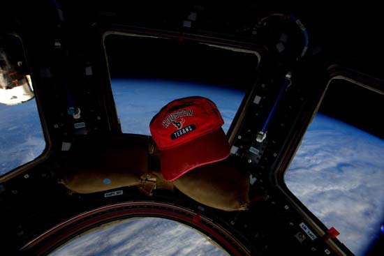 <div class='meta'><div class='origin-logo' data-origin='none'></div><span class='caption-text' data-credit=''>Kelly supports the Houston Texans on the Space Station</span></div>