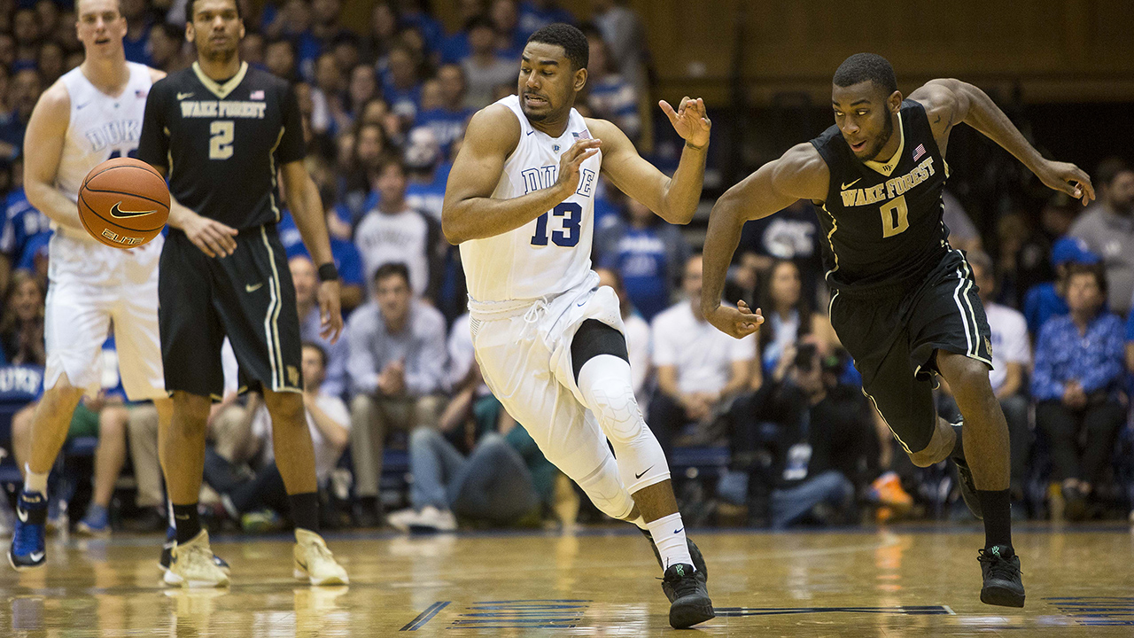 Duke's Matt Jones (13) and Wake Forest's Codi Miller-McIntyre (0) chase a loose ball Tuesday night.