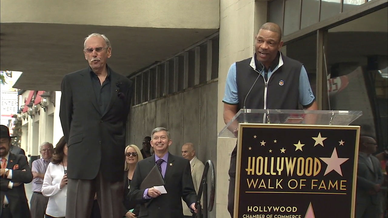 Clippers coach Doc Rivers introduces Ralph Lawler at the broadcaster's Hollywood Walk of Fame ceremony on Thursday, March 3, 2016.