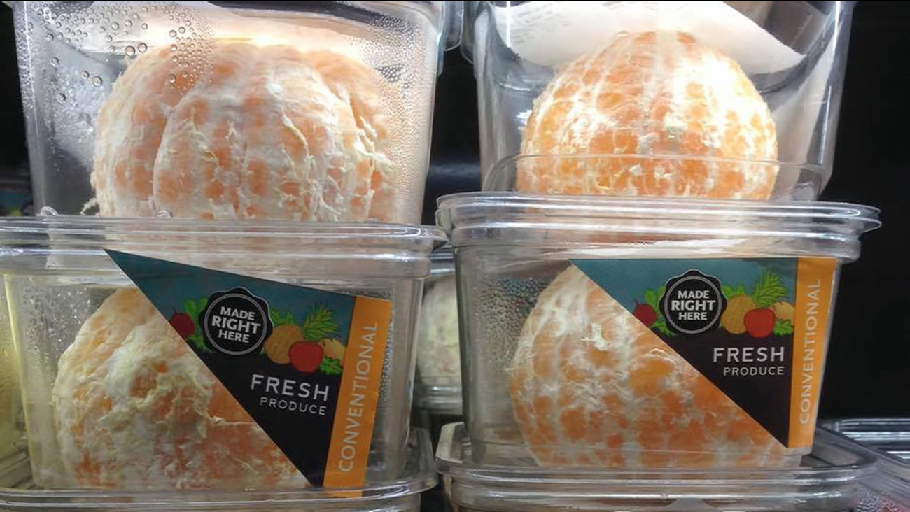 This undated images shows peeled oranges in plastic packaging at a Whole Foods in Oakland, Calif.