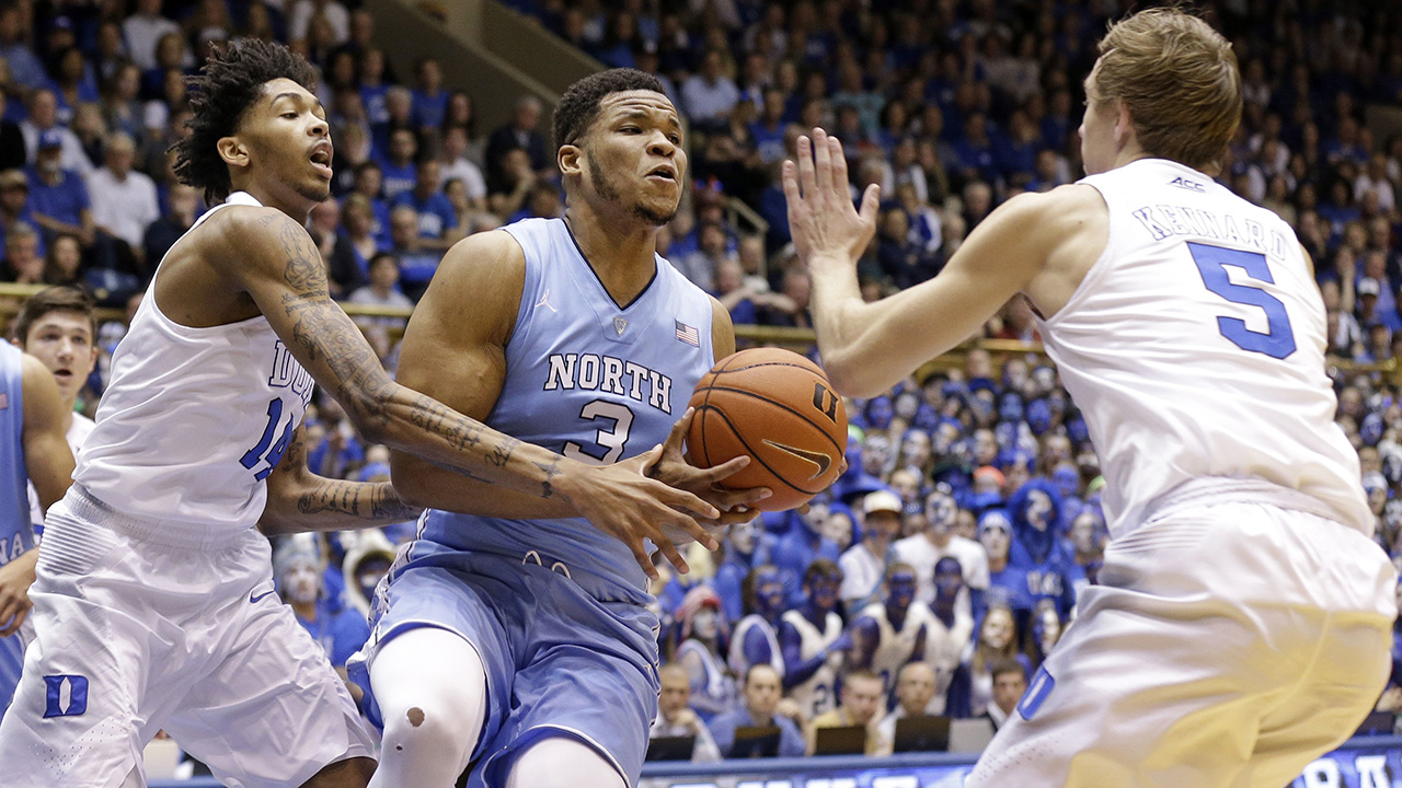 North Carolina's Kennedy Meeks (3) is pressured by Duke's Brandon Ingram, left, and Luke Kennard (5) during the first half of an NCAA college basketball game in Durham
