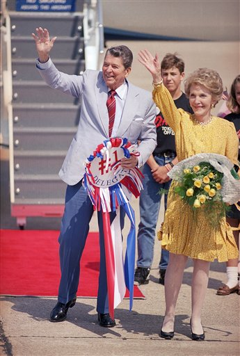 <div class='meta'><div class='origin-logo' data-origin='AP'></div><span class='caption-text' data-credit='AP'>Former President Ronald Reagan and his wife Nancy wave to about 100 supporters who greeted them as they arrived at Houston''s Hobby Airport</span></div>