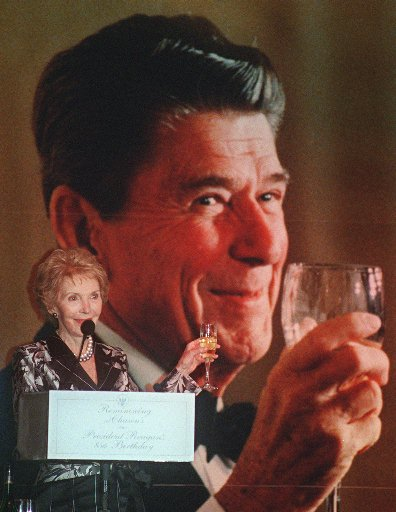 <div class='meta'><div class='origin-logo' data-origin='AP'></div><span class='caption-text' data-credit=''>Former First Lady Nancy Reagan raises her glass in front of a portrait of Ronald Reagan during her husband Former President Ronald Reagan's 85th birthday celebration</span></div>