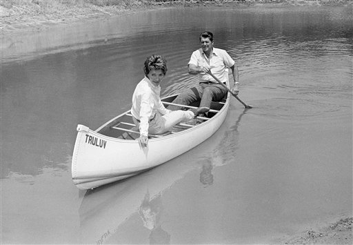 "<div class=""meta image-caption""><div class=""origin-logo origin-image ap""><span>AP</span></div><span class=""caption-text"">Ronald Reagan took his wife Nancy for a canoe ride on a pond at their mountain ranch near Santa Barbara (AP)</span></div>"