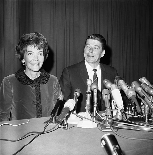 "<div class=""meta image-caption""><div class=""origin-logo origin-image ap""><span>AP</span></div><span class=""caption-text"">Ronald Reagan is joined by his wife Nancy at a press conference circa 1960s. (AP)</span></div>"