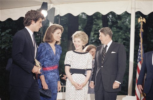 "<div class=""meta image-caption""><div class=""origin-logo origin-image ap""><span>AP</span></div><span class=""caption-text"">U.S. President  Ronald Reagan and his wife Nancy stand with John F. Kennedy Jr. and Jacqueline Kennedy Onassis talk suring a fund raiser (AP)</span></div>"