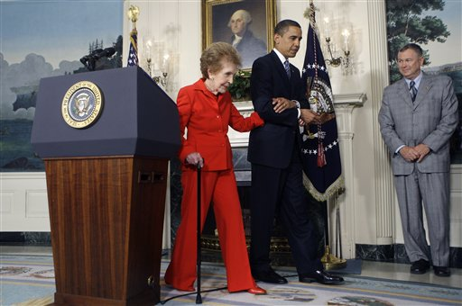 <div class='meta'><div class='origin-logo' data-origin='AP'></div><span class='caption-text' data-credit='AP'>President Barack Obama escorts former first lady Nancy Reagan in the Diplomatic Reception Room of the White House in 2009.</span></div>
