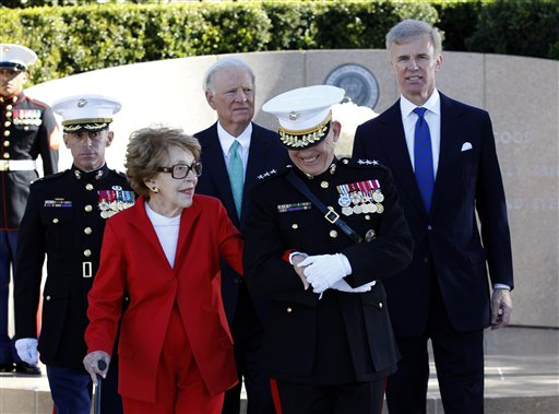 "<div class=""meta image-caption""><div class=""origin-logo origin-image ap""><span>AP</span></div><span class=""caption-text"">Former first lady Nancy Reagan is helped by Marine Lt. Gen. George J. Flynn as she arrives for a wreath laying ceremony at the memorial of her husband. (AP)</span></div>"