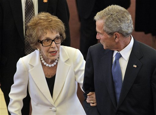 <div class='meta'><div class='origin-logo' data-origin='AP'></div><span class='caption-text' data-credit='AP'>Former first lady Nancy Reagan, left, is escorted by former President George W. Bush following the funeral for former first lady Betty Ford</span></div>