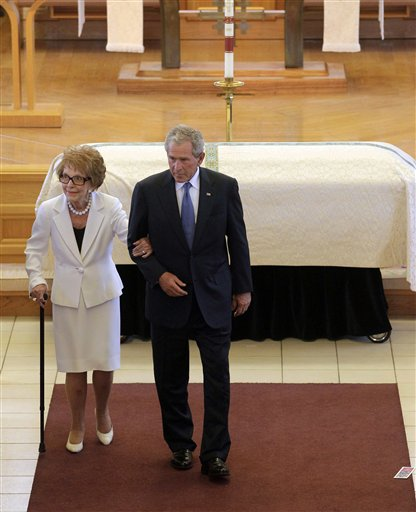 <div class='meta'><div class='origin-logo' data-origin='AP'></div><span class='caption-text' data-credit='ASSOCIATED PRESS'>Former first lady Nancy Reagan, left, is escorted by former President George W. Bush following the funeral for former first lady Betty Ford.</span></div>