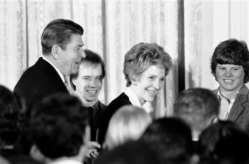 <div class='meta'><div class='origin-logo' data-origin='AP'></div><span class='caption-text' data-credit='ASSOCIATED PRESS'>Olympic medalist, figure skater, Scott Hamilton, is framed by President Ronald Reagan and Nancy Reagan at a White House reception February 29, 1984</span></div>
