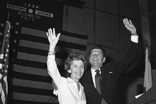 <div class='meta'><div class='origin-logo' data-origin='AP'></div><span class='caption-text' data-credit='AP'>Ronald Reagan, Republican candidate for President and his wife Nancy, raises their arms in response to a loud applause</span></div>