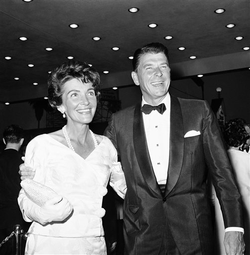 "<div class='meta'><div class='origin-logo' data-origin='AP'></div><span class='caption-text' data-credit='AP'>Arriving for the West coast premiere of ""Cleopatra"" at Pentagon Theater in Hollywood, Los Angeles on June 19, 1963 are Ronald Reagan and wife actress Nancy Davis</span></div>"