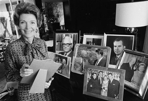 <div class='meta'><div class='origin-logo' data-origin='AP'></div><span class='caption-text' data-credit='AP'>Nancy Reagan poses with some of the memorabilia in Pacific Palisades, Calif., on March 12, 1975</span></div>