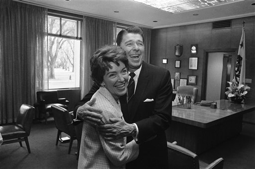 "<div class=""meta image-caption""><div class=""origin-logo origin-image ap""><span>AP</span></div><span class=""caption-text"">California Gov. Ronald Reagan gives his wife, Nancy, a surprise hug as she leaves his office in Sacramento on April 27, 1967 (AP)</span></div>"