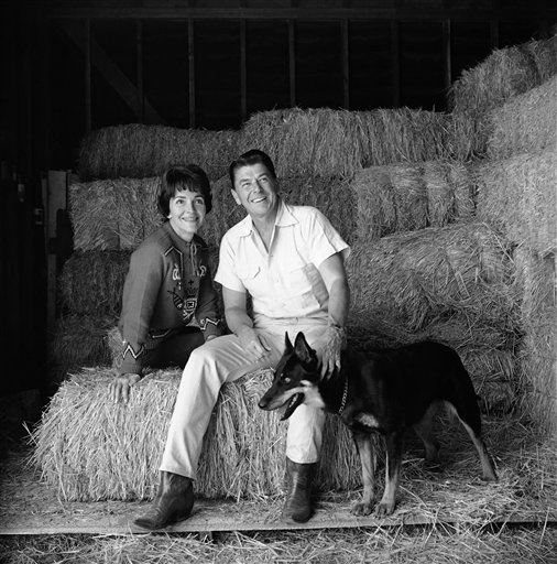 "<div class=""meta image-caption""><div class=""origin-logo origin-image ap""><span>AP</span></div><span class=""caption-text"">Ronald Reagan and his wife, actress Nancy Davis, discuss the merits of a tractor on their 305 acre ranch in the Santa Monica (AP)</span></div>"
