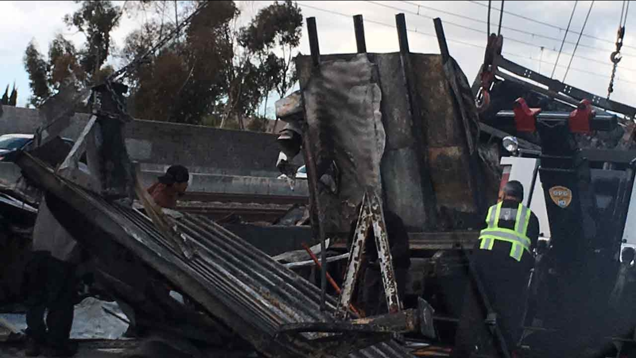 Blackened pieces left of what was a big rig that crashed into a center divider on the 210 Freeway in Pasadena on Sunday, March 6, 2016.