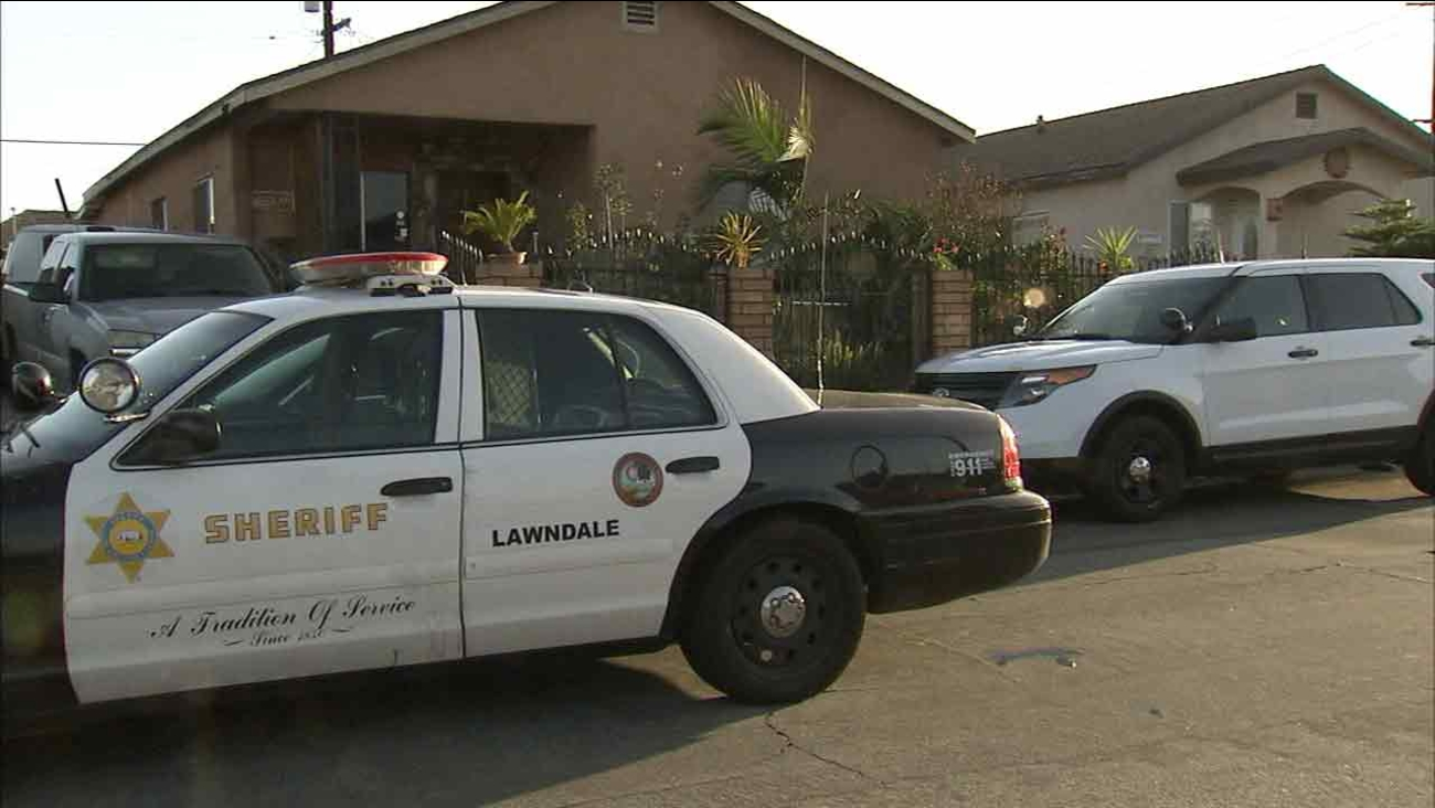 Sheriff's deputies respond to the scene where a man was beaten to death in Lawndale, Calif. on Sunday, March 6, 2016.