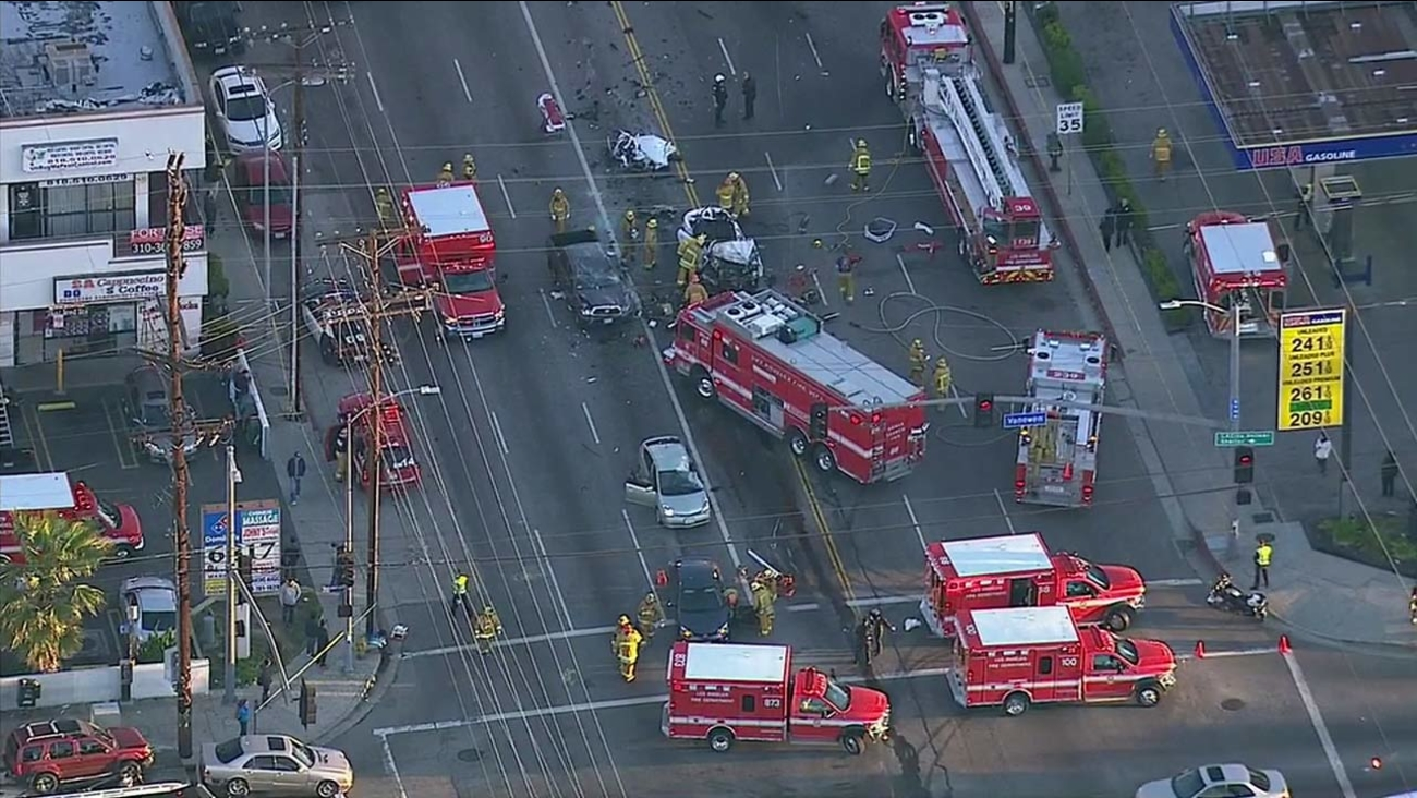 Emergency crews work on scene of a multi-vehicle crash near the intersection of Vanowen Street and Sepulveda Boulevard on Tuesday, March 8, 2016.