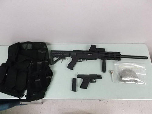 Firearms were found in 33-year-old Khamprasong Thammavong's home in Fresno following a probation search.