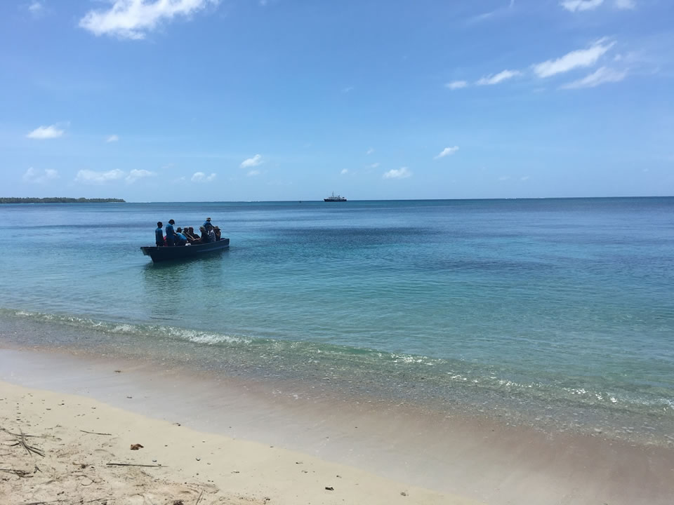 """<div class=""""meta image-caption""""><div class=""""origin-logo origin-image none""""><span>none</span></div><span class=""""caption-text"""">This image taken in March 2016 shows Exploratorium workers landing on the remote island of Woleai, a tiny atoll in Micronesia. (The Exploratorium)</span></div>"""