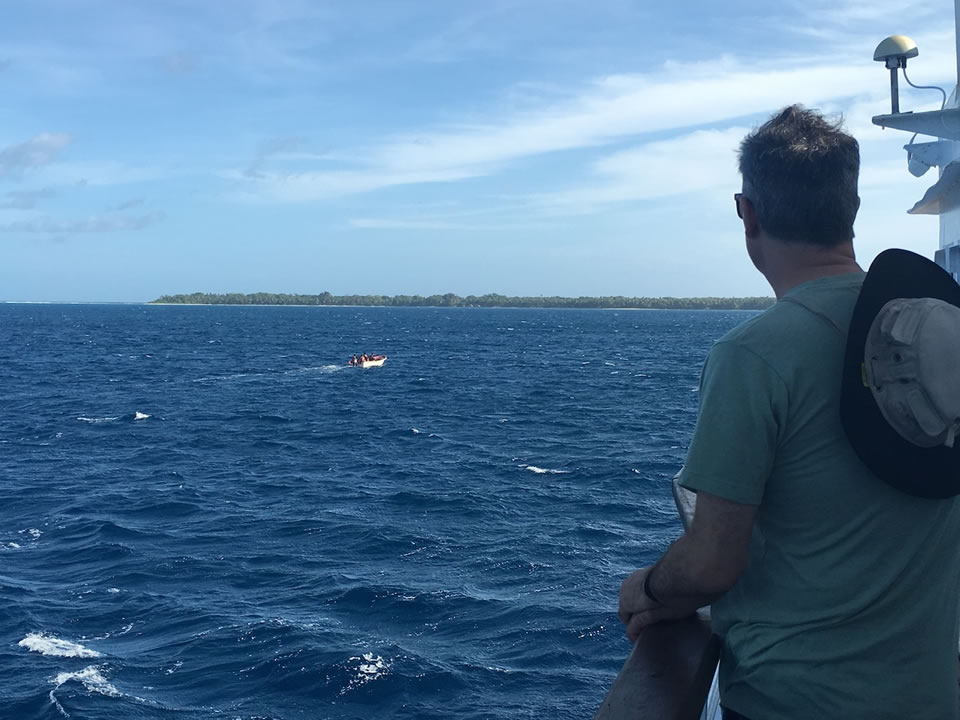 """<div class=""""meta image-caption""""><div class=""""origin-logo origin-image none""""><span>none</span></div><span class=""""caption-text"""">This image taken in March 2016 shows Exploratorium workers on a skiff leaving for the remote island of Woleai, a tiny atoll in Micronesia. (The Exploratorium)</span></div>"""