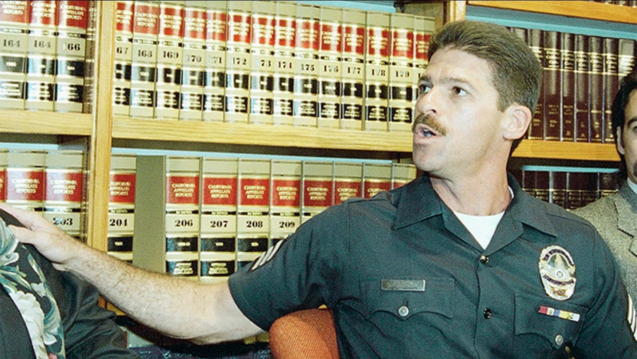 Retired Los Angeles police Sgt. Mitchell Grobeson, pictured here at a 1994 press conference, was charged on Tuesday, March 8, 2016 with pointing a gun at his husband.