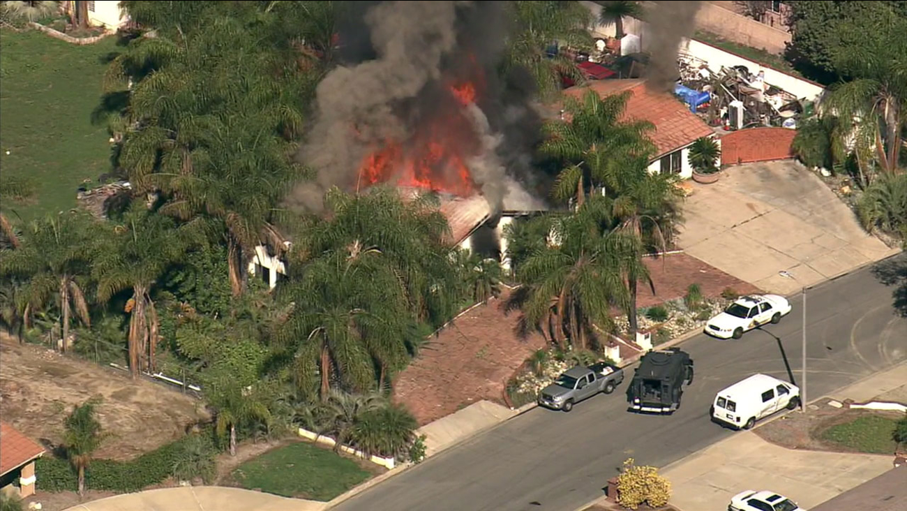 A house erupts in flames during a standoff in Chino on Wednesday, March 9, 2016.