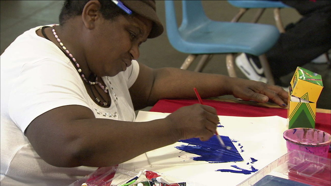 With concentration and a steady hand, a participant in the Midnight Mission's 'Art with a Mission' program creates her masterpiece.
