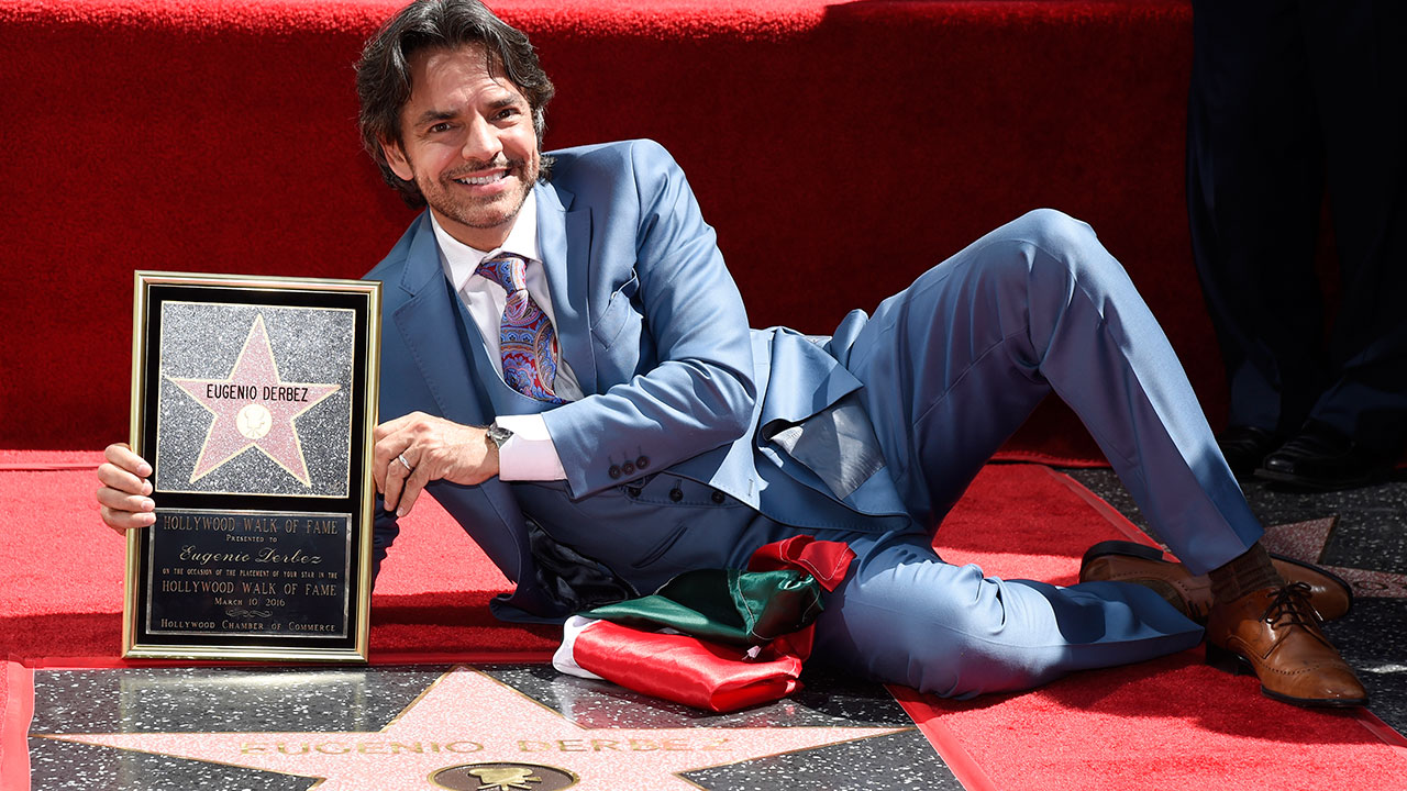 Mexican actor/writer/director Eugenio Derbez poses atop his new star on the Hollywood Walk of Fame during a ceremony on Thursday, March 10, 2016, in Los Angeles.