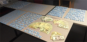"<div class=""meta image-caption""><div class=""origin-logo origin-image none""><span>none</span></div><span class=""caption-text"">Pictured: Drugs seized after arrest of Darren Swiggett.</span></div>"
