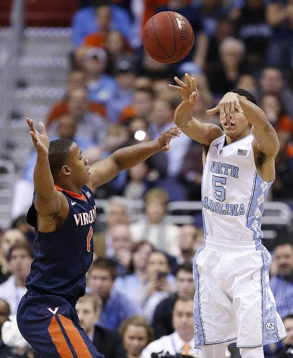 <div class='meta'><div class='origin-logo' data-origin='AP'></div><span class='caption-text' data-credit='Alex Brandon'>North Carolina guard Marcus Paige (5) passes the bad over Virginia guard Devon Hall (0) during the first half of an NCAA college basketball game</span></div>