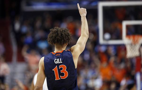<div class='meta'><div class='origin-logo' data-origin='none'></div><span class='caption-text' data-credit='Alex Brandon'>Virginia forward Anthony Gill (13) signals to teammates during the second half of an NCAA college basketball game in the championship of the Atlantic Coast Conference tournament</span></div>