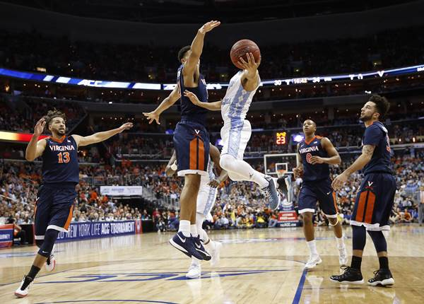 <div class='meta'><div class='origin-logo' data-origin='none'></div><span class='caption-text' data-credit='Alex Brandon'>North Carolina guard Marcus Paige (5) shoots against Virginia forward Isaiah Wilkins (21) during the second half of an NCAA college basketball game</span></div>