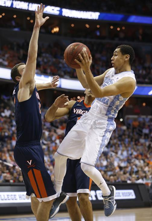 <div class='meta'><div class='origin-logo' data-origin='AP'></div><span class='caption-text' data-credit='Steve Helber'>North Carolina guard Marcus Paige (5) shoots against Virginia center Mike Tobey (10) during the second half of an NCAA college basketball game</span></div>