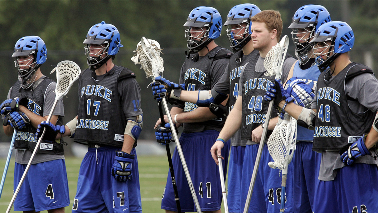 Duke lacrosse players listen during practice in Durham, N.C., Monday, Sept. 4, 2006.