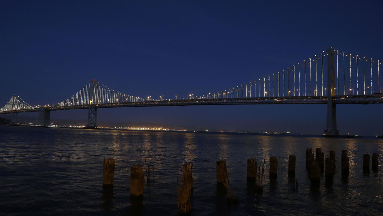 In this Wednesday, Feb. 20, 2013, photo, lights are turned on along the western half of the Bay Bridge on Pier 14 in San Francisco. (AP Photo/Jeff Chiu)