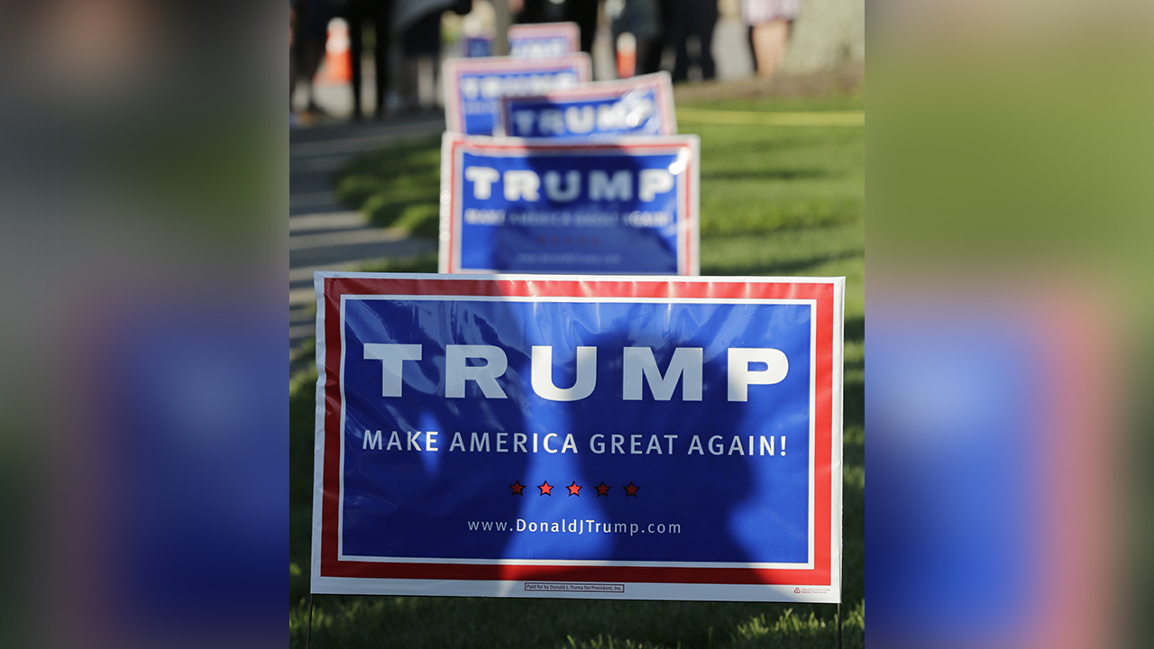 Republican presidential candidate Donald Trump signs during a campaign stop at Winnacunnet High School in Hampton, N.H., Friday, Aug. 14, 2015.