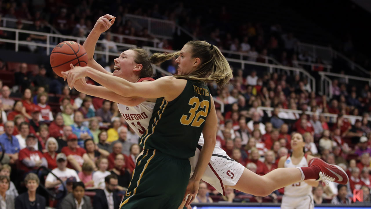 Stanford forward Alanna Smith, left, battles for a rebound against San Francisco forward Taylor Proctor (32) in a first-round women's college basketball game March 19, 2016.