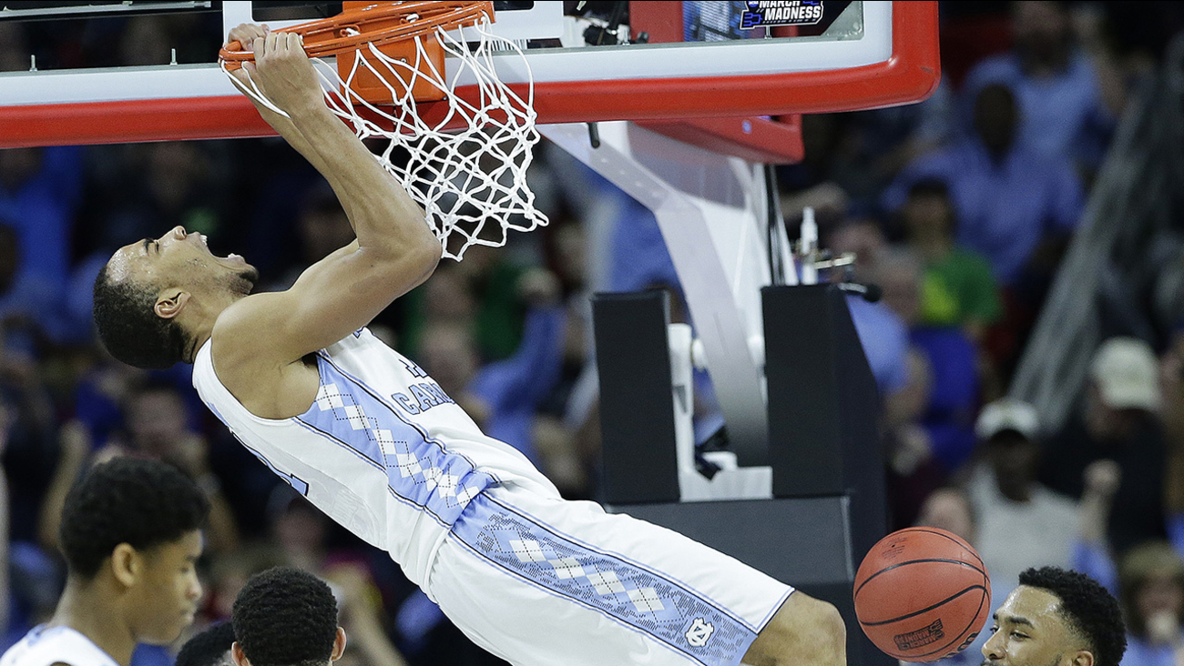 North Carolina forward Brice Johnson (11) reacts after dunking the ball against Providence guard Jalen Lindsey (21) during the second half