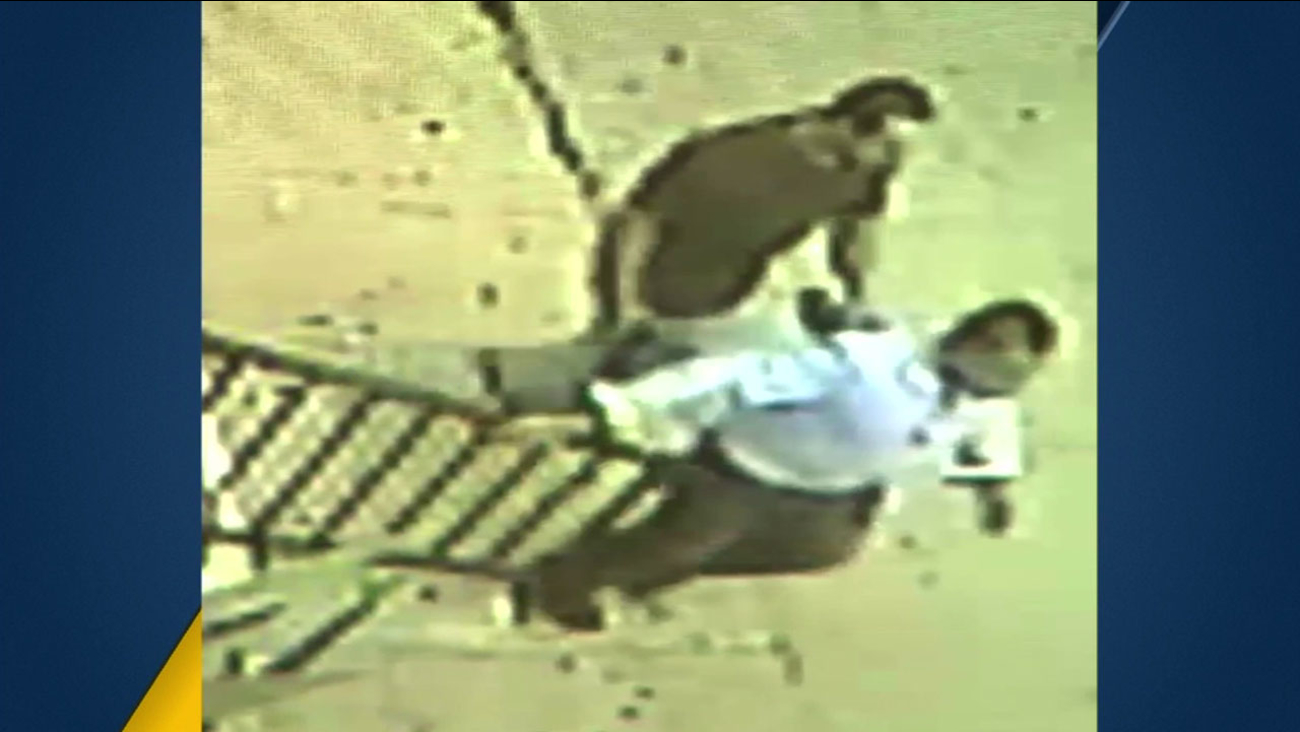 Surveillance video shows a suspect holding a gun against a man's back in a possible kidnapping in East Los Angeles on Saturday, March 19, 2016.