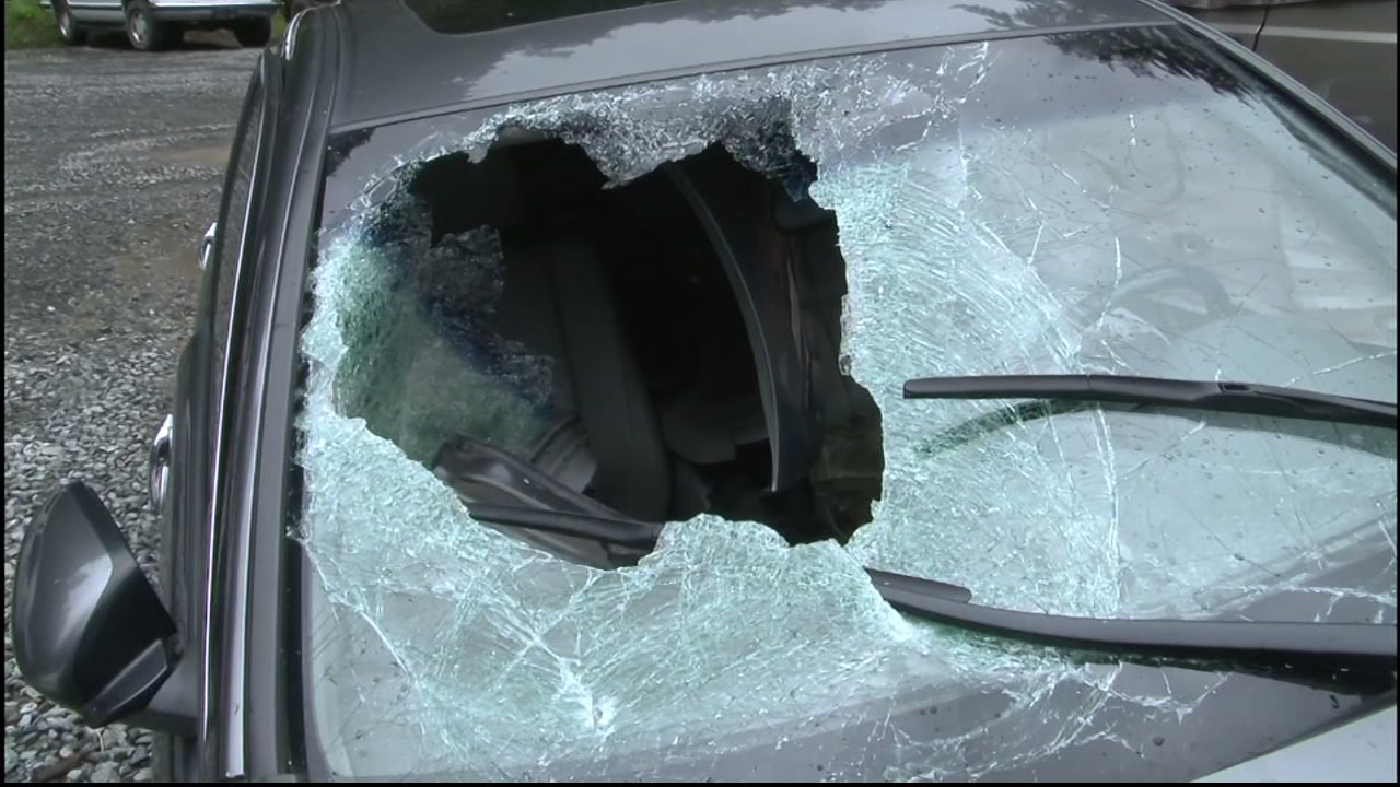 A boulder flew through the windshield of a car driving on Cazadero Highway in Sonoma County, Calif. on Monday, March 21, 2016.