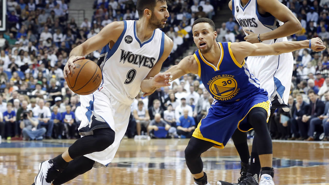 Minnesota Timberwolves' Ricky Rubio, left, of Spain, drives around Golden State Warriors' Stephen Curry in the first quarter of an NBA basketball game Monday, March 21, 2016, in Minneapolis.
