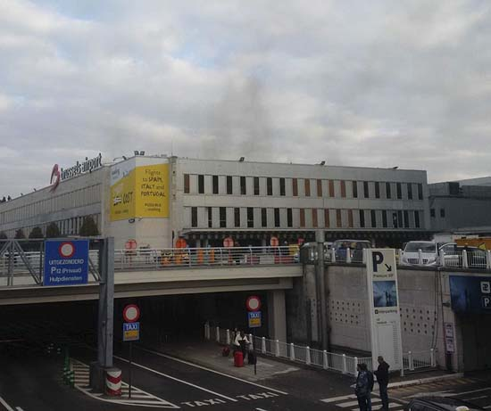 <div class='meta'><div class='origin-logo' data-origin='AP'></div><span class='caption-text' data-credit='Daniela Schwarzer via AP'>Smoke is seen at Brussels airport in Brussels, Belgium, after explosions were heard Tuesday, March 22, 2016.</span></div>